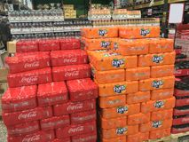 Coca Cola and Fanta soft drink cans in stacks of boxes at a wholesale supermarket. Copenhagen, Denmark - April 19, 2019 stock photo