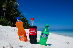 Coca-cola, fanta, sprite bottles on the beach Royalty Free Stock Images