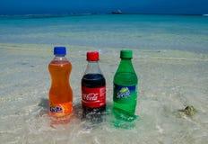 Coca-cola, fanta, sprite bottles on the beach Royalty Free Stock Photo