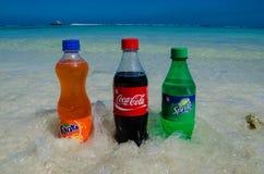 Coca-cola, fanta, sprite bottles on the beach Royalty Free Stock Image