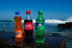 Coca-cola, fanta, sprite bottles on rock Stock Photo