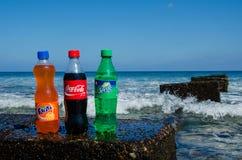 Coca-cola, fanta, sprite bottles on rock Stock Photography