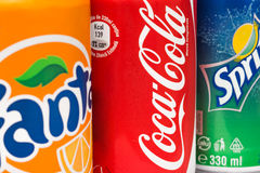 Coca-Cola, Fanta and Sprite Cans. BUCHAREST, ROMANIA - DECEMBER 26, 2013: Coca-Cola, Fanta and Sprite Cans. The three drinks produced by the Coca-Cola Company Stock Image