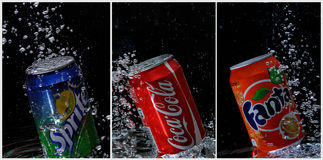Coca cola, fanta, sprite cans under water. In bubble black background Stock Photography