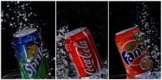 Coca Cola, fanta, Spritedosen unter Wasser Stockfotografie