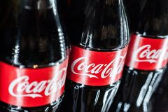 Minsk, Belarus, May 27, 2018: Coca-Cola glass bottles in the fridge  close up. Coca-Cola glass bottles in the fridge close up Stock Photography