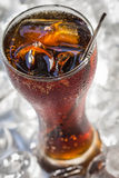 Coca cola. A glass of cola with ice cubes Stock Photos