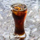 Coca cola. A glass of cola with ice cubes Royalty Free Stock Photos
