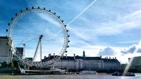 Coca-Cola London Eye contrasted against a crisp blue sky. royalty free stock photo