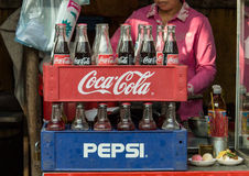 Coca-Cola and  Pepsi bottles stacked in plastic container - vint Royalty Free Stock Photo