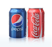 Coca cola and Pepsi cans. With water drops