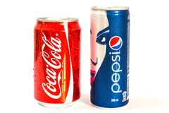 Coca cola and Pepsi cans. Coca cola and Pepsi can isolated on white background Stock Image