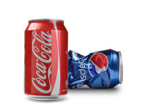 Coca-Cola and Pepsi cans. Concept of competitiveness on  Coca-Cola vs Pepsi Royalty Free Stock Images