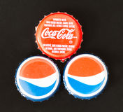 Coca Cola and Pepsi Cola Bottle Caps Stock Images