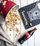 Coca cola popcorn and magazine Stock Photos