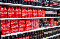 Coca Cola on shelves. Shelves of Coca Cola for sale in a supermarket in Portugal Stock Photos