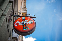 Coca-Cola shield. KLAIPEDA - JUN 1: Coca-Cola shield on June 1, 2014 in Klaipeda, Lithuania. The Coca-Cola Company is an American multinational beverage Royalty Free Stock Image