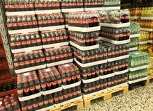 Coca Cola soft drink bottles in stacks of boxes at a wholesale supermarket. Copenhagen, Denmark - April 19, 2019 stock images