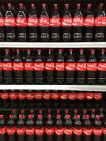Coca cola. Soft drinks on supermarket shelves Royalty Free Stock Photography