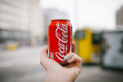 Coca cola can in the hand Stock Photo