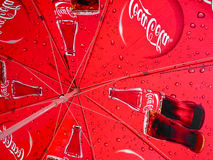 Coca Cola umbrella. This image can be used for anything connected with the brand name Coca-Cola: news, events, articles, reviews, etc Royalty Free Stock Photo