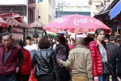 Coca-Cola umbrella in eighth market of amoy city, china Stock Image