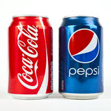 Coca Cola Versus Pepsi. Two of the beverage industry's leading competitors Royalty Free Stock Photo
