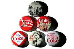 Coca-Cola vintage bottle caps. Bucharest, Romania - November 29, 2011: Five vintage Coca-Cola bottle caps, 125 years old anniversary edition, studio shot stock images