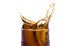 coca - colafärgstänk Arkivfoto