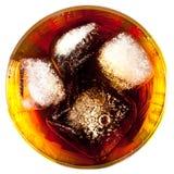 Coca con hielo en un vidrio Imagen de archivo