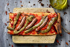 Coca de recapte, catalan savory cake similar to pizza. High-angle shot of a slice of coca de recapte, a typical catalan savory cake similar to pizza, made with stock images