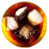 Coca with ice in a glass. On a white background Stock Image