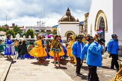 Cocacabana, Bolivia 30th April 2017: Group of local people celebrating parade and playing drum and woman in dress dancing stock photo