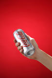 Cocacola. Kuala Lumpur,Malaysia 11th July 2016, Hand hold a can Coca-Cola light on white background. Coca Cola drinks are produced and manufactured by The Coca Stock Photos