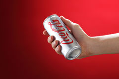 Cocacola. Kuala Lumpur,Malaysia 11th July 2016, Hand hold a can Coca-Cola light on white background. Coca Cola drinks are produced and manufactured by The Coca Royalty Free Stock Photos