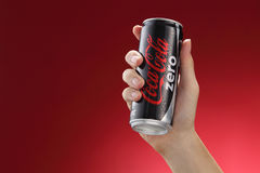 Cocacola. Kuala Lumpur,Malaysia 11th July 2016, Hand hold a  can Coca-Cola Zero on red  background. Coca Cola drinks are produced and manufactured by The Coca Stock Photos