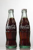 Cocacola. Kuala Lumpur Malaysia,18th July 2016,two classic cocacola bottle on the white background Royalty Free Stock Photography