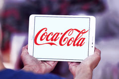 Cocacola logo. Logo of drinks company cocacola on samsung tablet in hands Stock Photography