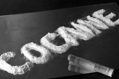 Cocaine. Word Written on a Mirror with 50 Stock Photos