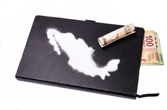 Cocaine all over Mexico. Map of mexico made of cocaïne on a black notebook from which some bills come out stock photography