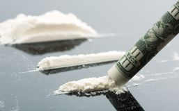 Cocaine and 10 dollars note. Cocaine lines and 10 dollars on grey background Stock Photo
