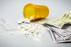 Cocaine drug powder pile along with several dollar tickets Stock Photo