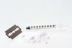 Cocaine drug. On table. Drugs concept.razor blade and syringe Royalty Free Stock Images