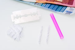 Cocaine drug. On table. Drugs concept.razor blade and syringe Royalty Free Stock Image