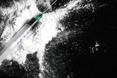 Cocaine drugs heap with syringe Stock Photography