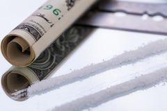 Cocaine lines on mirror with razor blade drugs Stock Photo