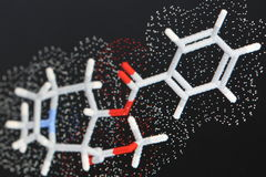 Cocaine molecule 1. Close up of modeled molecule of cocaine with sticks and van der waals radii dot surface, shallow DOF royalty free stock photography