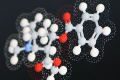 Cocaine molecule 2. Close up of modeled molecule of cocaine with sticks and balls and van der waals radii dot surface, shallow DOF Royalty Free Stock Photos