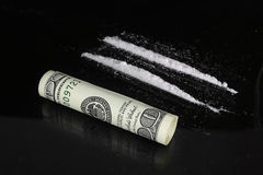 Cocaine and one hundred dollars Stock Images