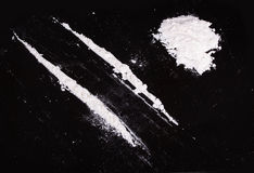 Cocaine powder in lines Royalty Free Stock Image